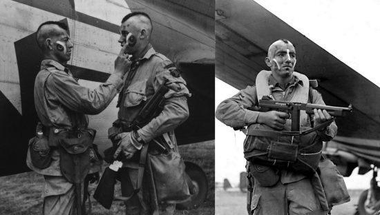 """Clarence Ware e Charles Plaudo (a sinistra) dei """"13 Lercioni"""", 5 giugno 1944, con cresta e colori di guerra in onore delle origini indiane Choctaw del sergente Jack McNiece (a destra)."""